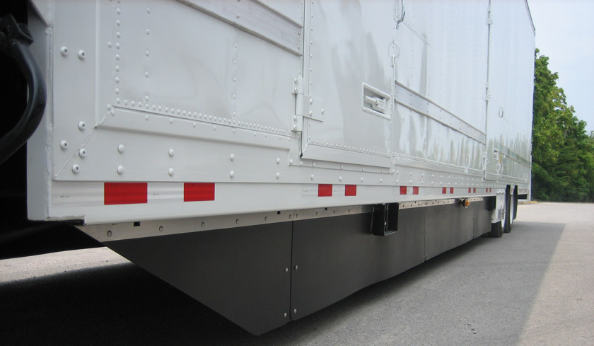 Semi truck with the Freight Wing E-Van custom Belly Fairing